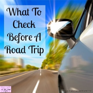car on the road with motion blur and sunlight in the mirror - Text Overlay of - What To Check Before A Road Trip